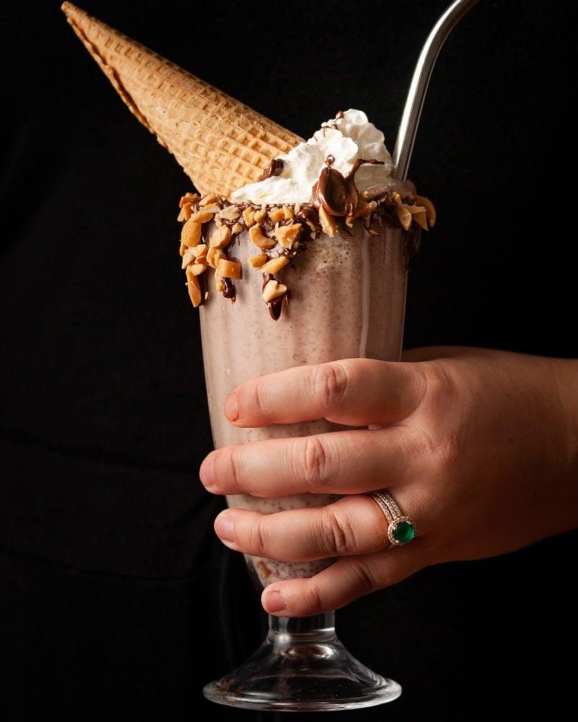 Hand Holding Nutella Milkshake