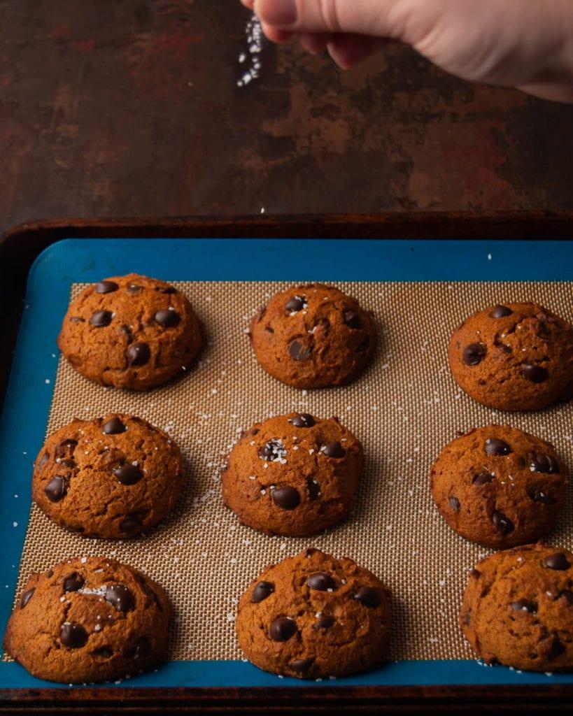 sprinkling sea salt on freshly baked cookies