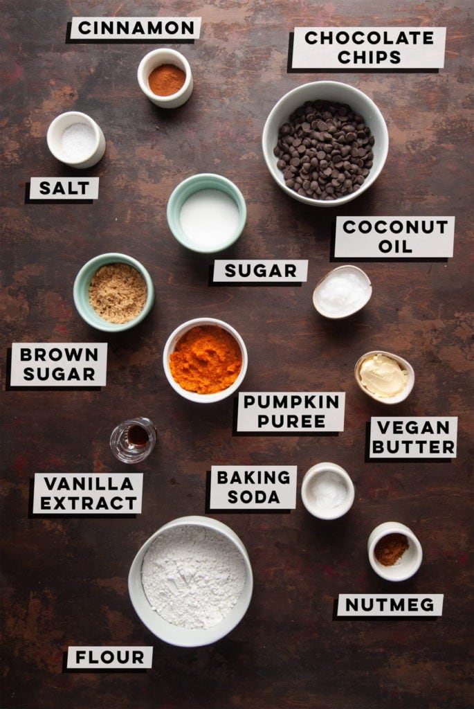 cinnamon, chocolate chips, baking powder, white sugar, brown sugar, pumpkin puree. coconut oil, vegan butter, vanilla extract, salt, nutmeg, and flour