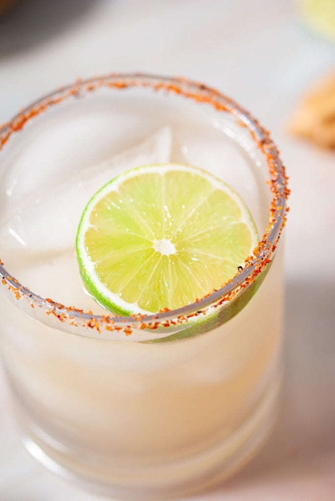 close up shot of a vodka margarita with lime slice