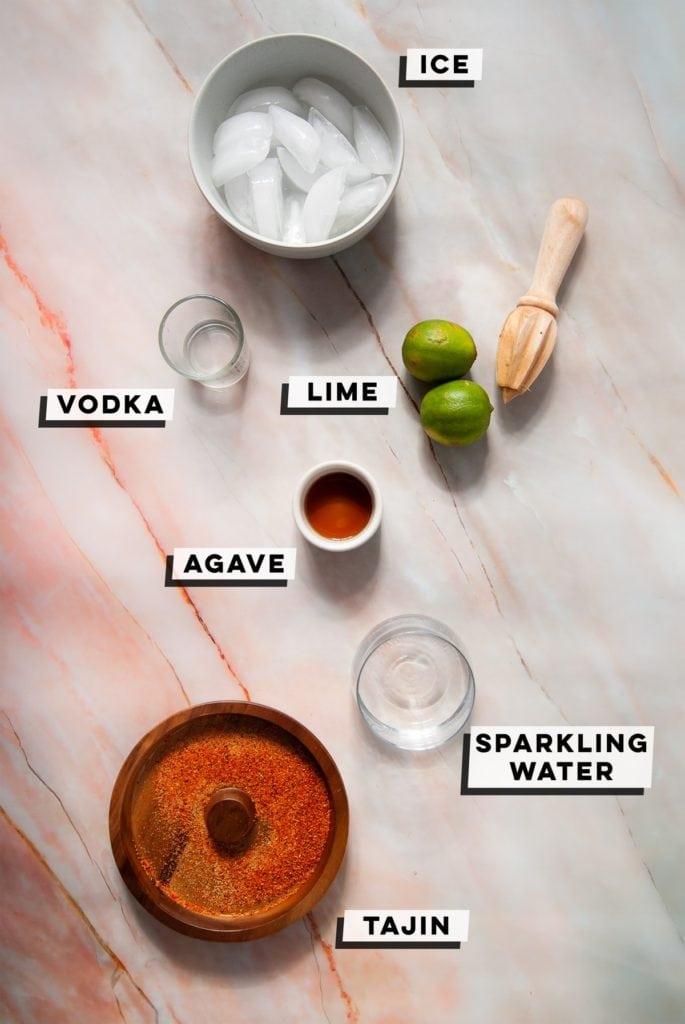 ice, limes, vodka, agave nectar, sparkling water, tajin