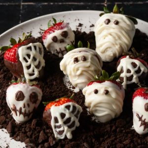 plate of variety of halloween festive chocolate covered strawberries