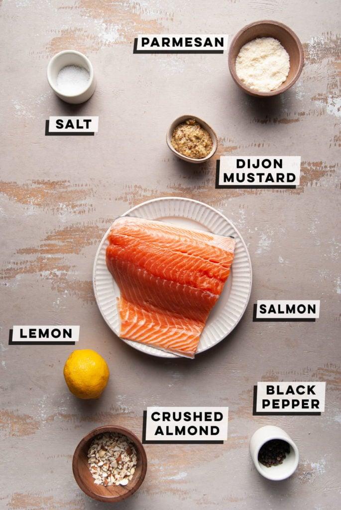salt, parmesan, dijon mustard, salmon, lemon, crushed almonds, black pepper
