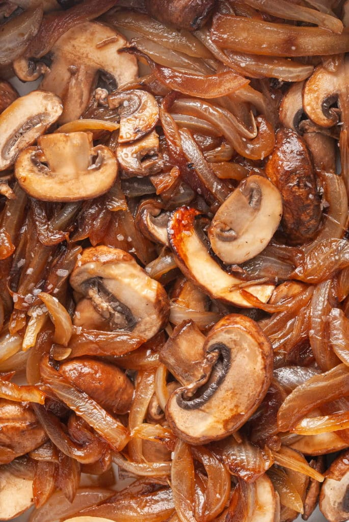 close up of cooked mushrooms and onions