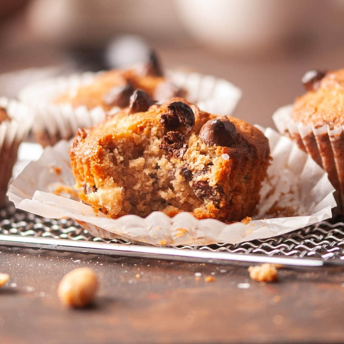 close up of peanut butter chocolate chip muffin with bite taken out
