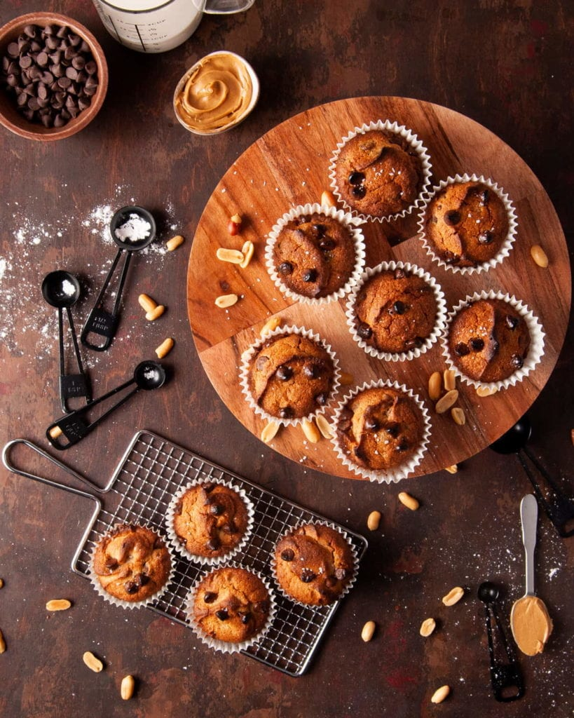cake stand and cooling rack full of muffins