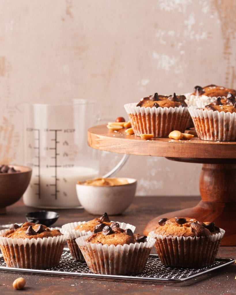 scene with milk and peanut butter and peanuts and a lot of muffins