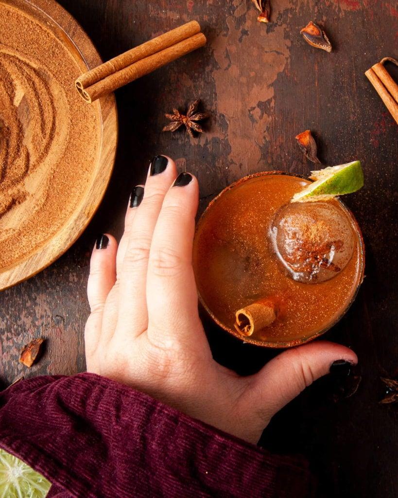 hand grabbing for a pumpkin spice margarita