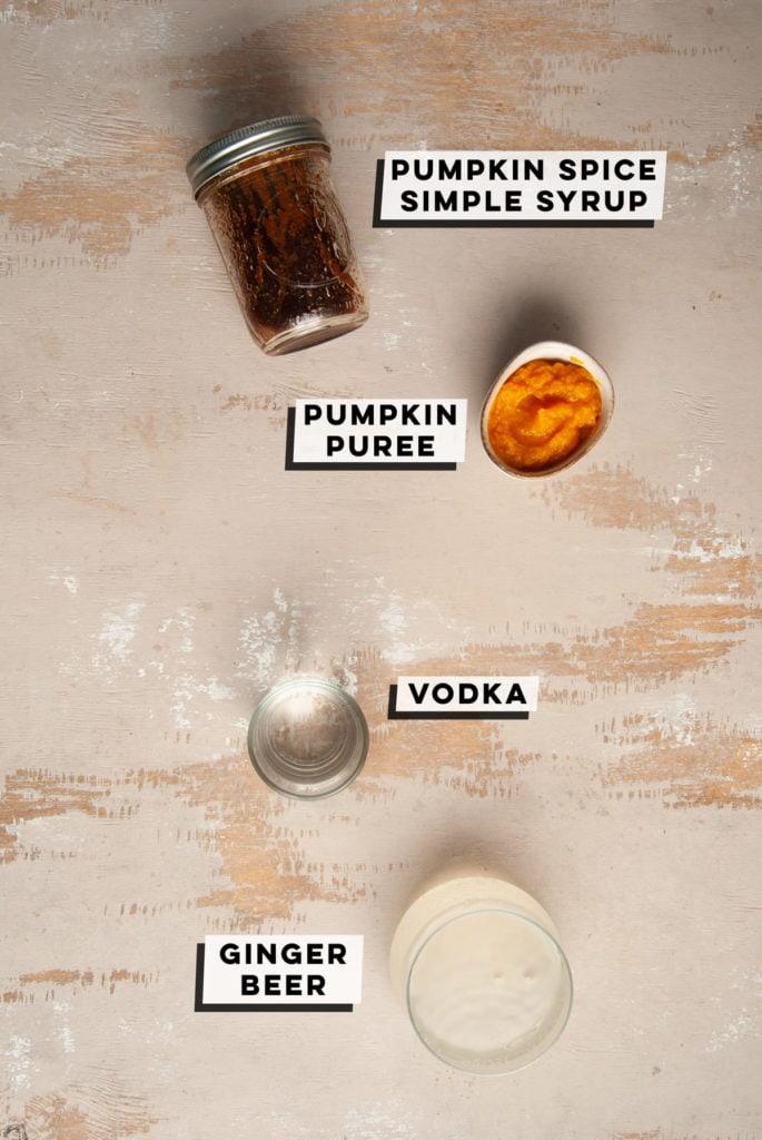 pumpkin spice simple syrup, pumpkin puree, vodka, and ginger beer