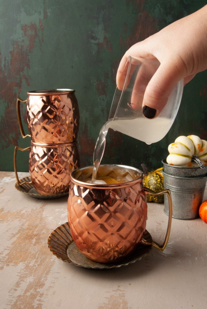 topping pumpkin spice mule with ginger beer