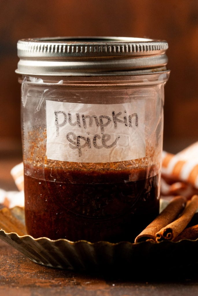 """simple syrup in a jar with """"pumpkin spice"""" label"""