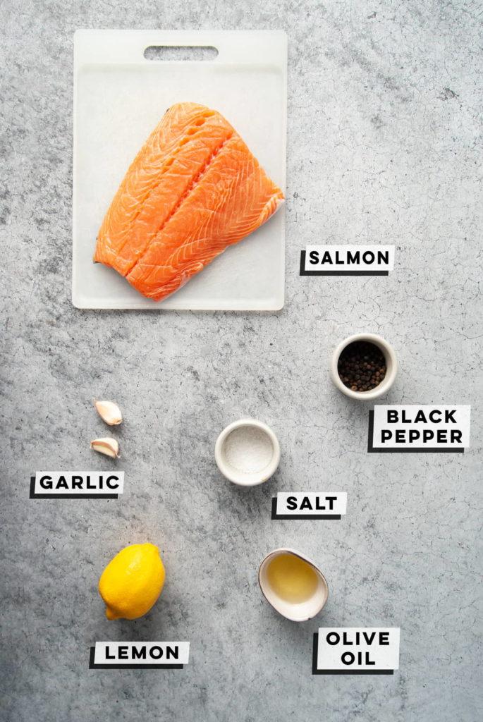 salmon, pepper, salt, garlic, lemon, and olive oil