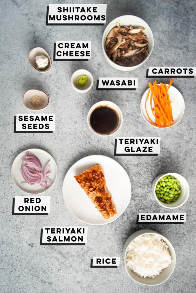 shiitake mushrooms, cream cheese, wasabi, carrots, sesame seeds, red onion, teriyaki glazed salmon, edamame, and white rice