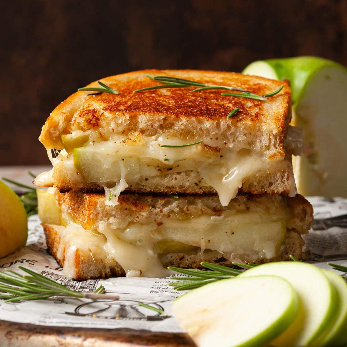 grilled cheese with brie oozing out and apple slices