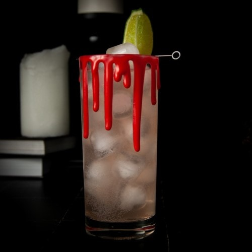 halloween cocktail with edible fake blood rim