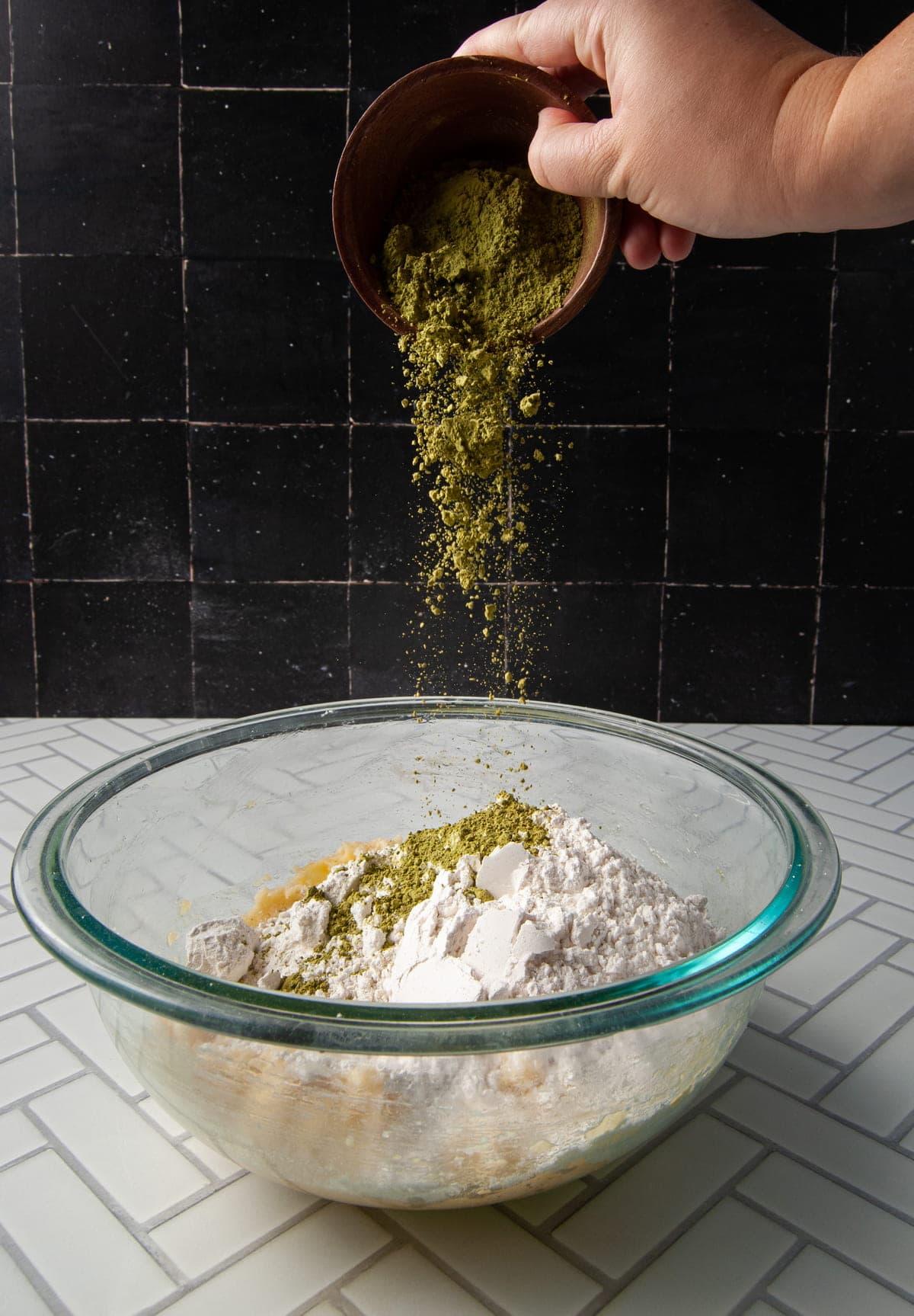 adding matcha powder to cookie dough