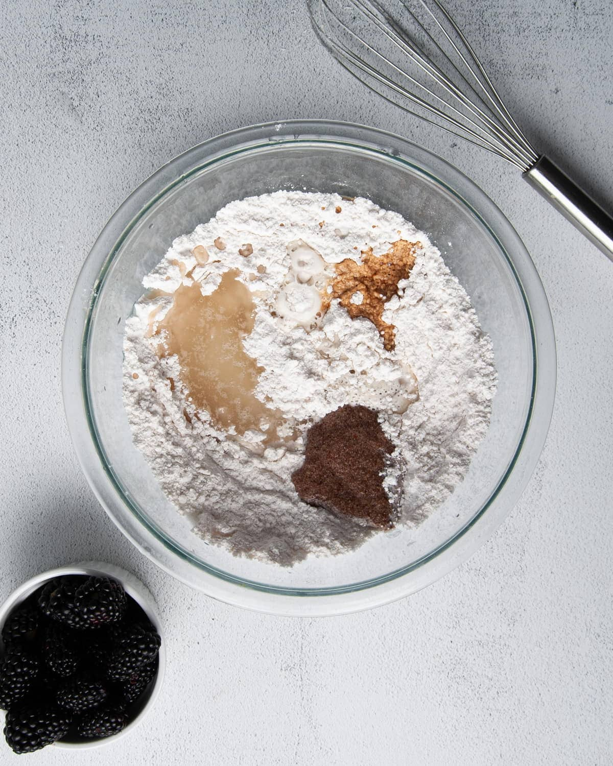 adding non-dairy milk, flac egg, vanilla extract, and oil to muffin batter