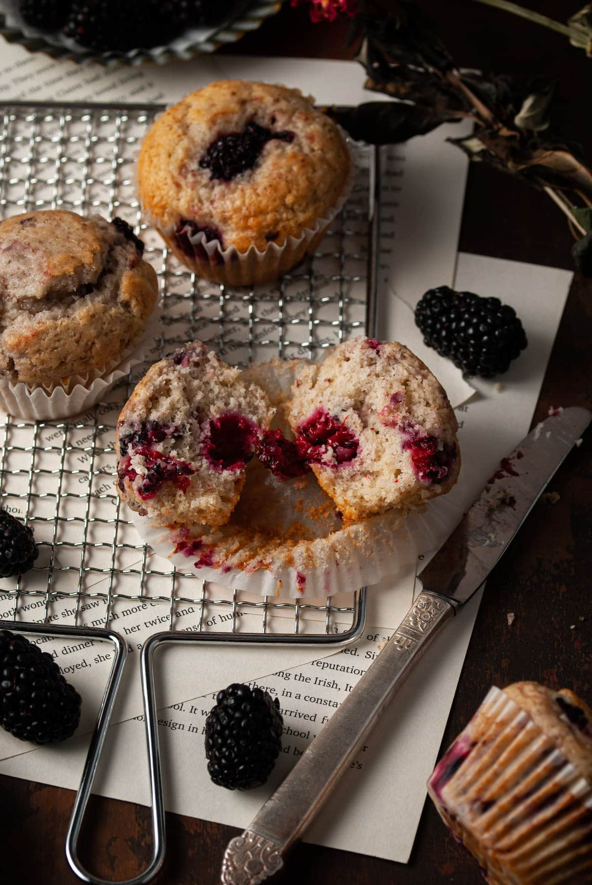 vegan blackberry muffins with one cut open
