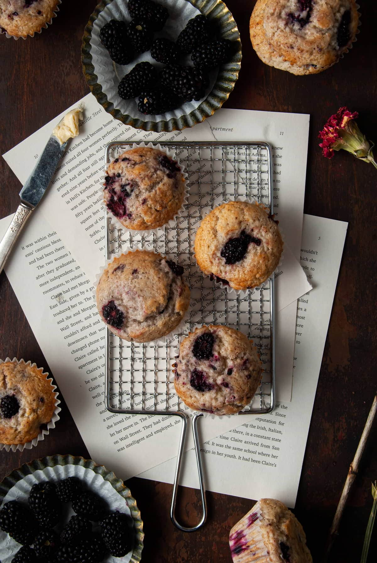 overhead shot of fluffy muffins and knife with butter