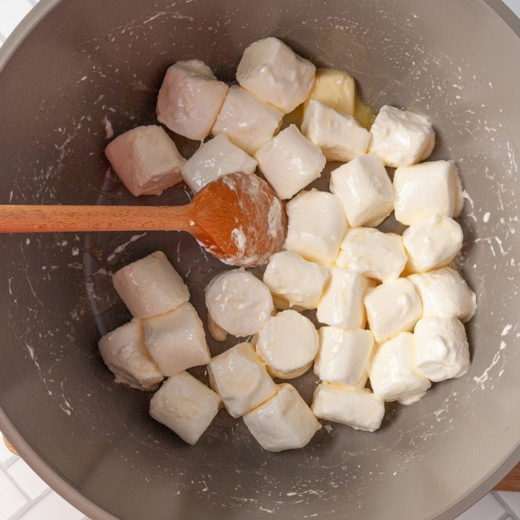 melting marshmallows and butter in a pot