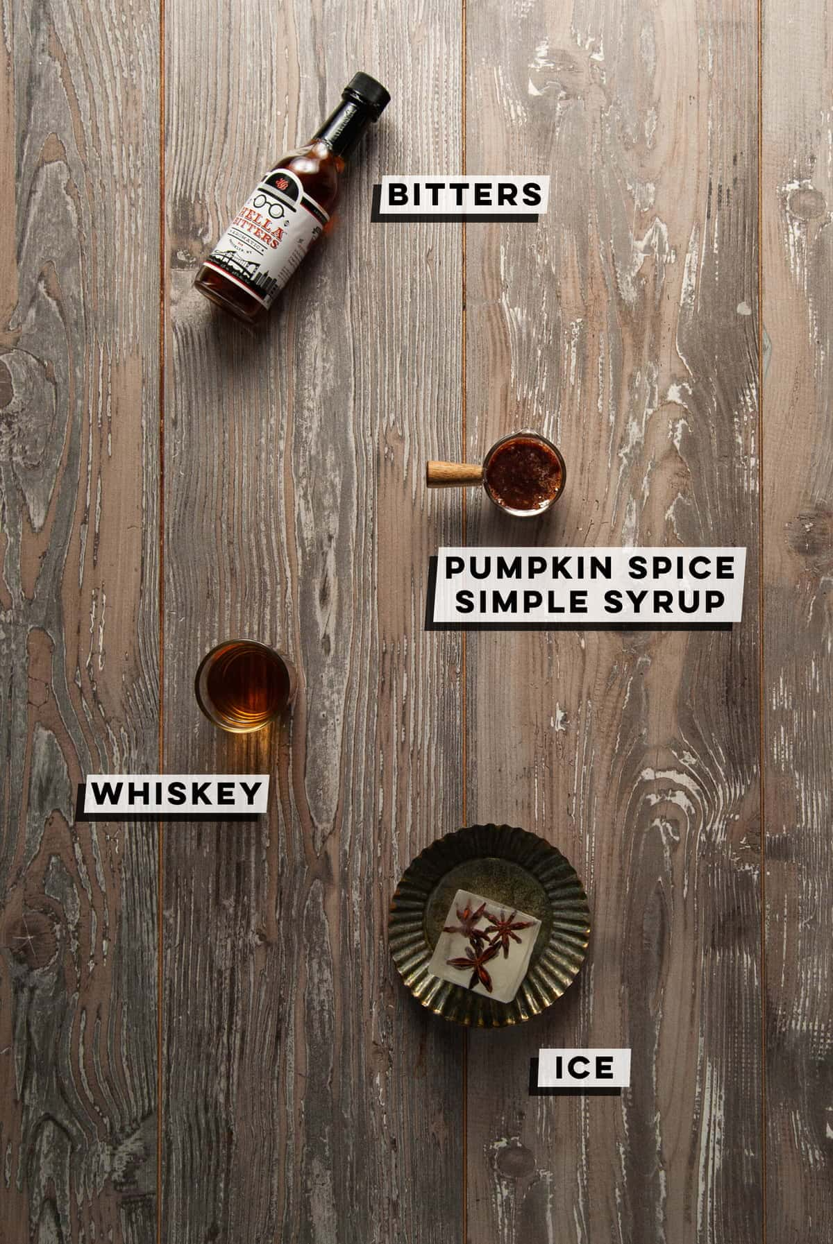 aromatic bitters, pumpkin spice simple syrup, whiskey, ice