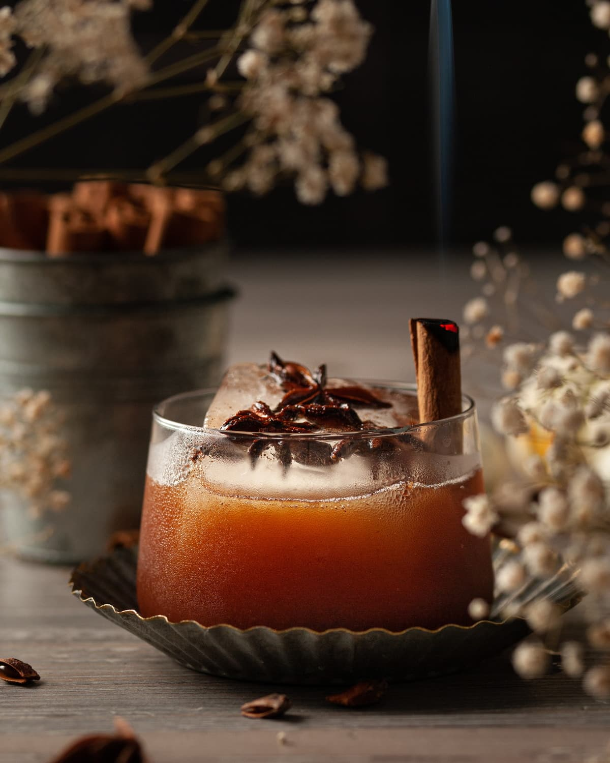 pumpkin spice old fashioned with burning cinnamon stick
