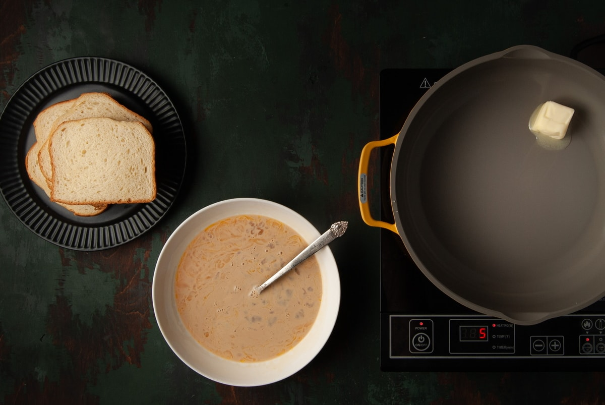 bread, egg wash, and butter in pan getting hot