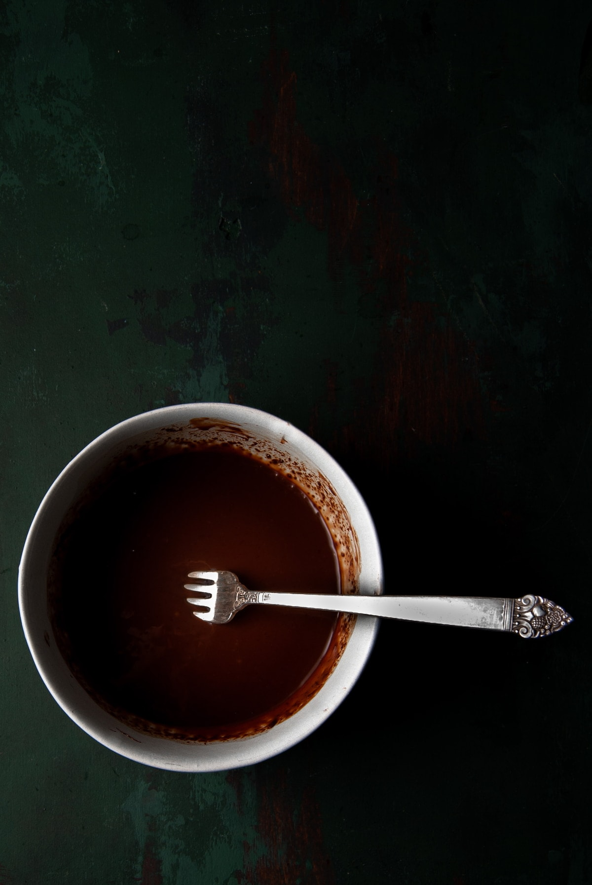 melted chocolate with a fork in it