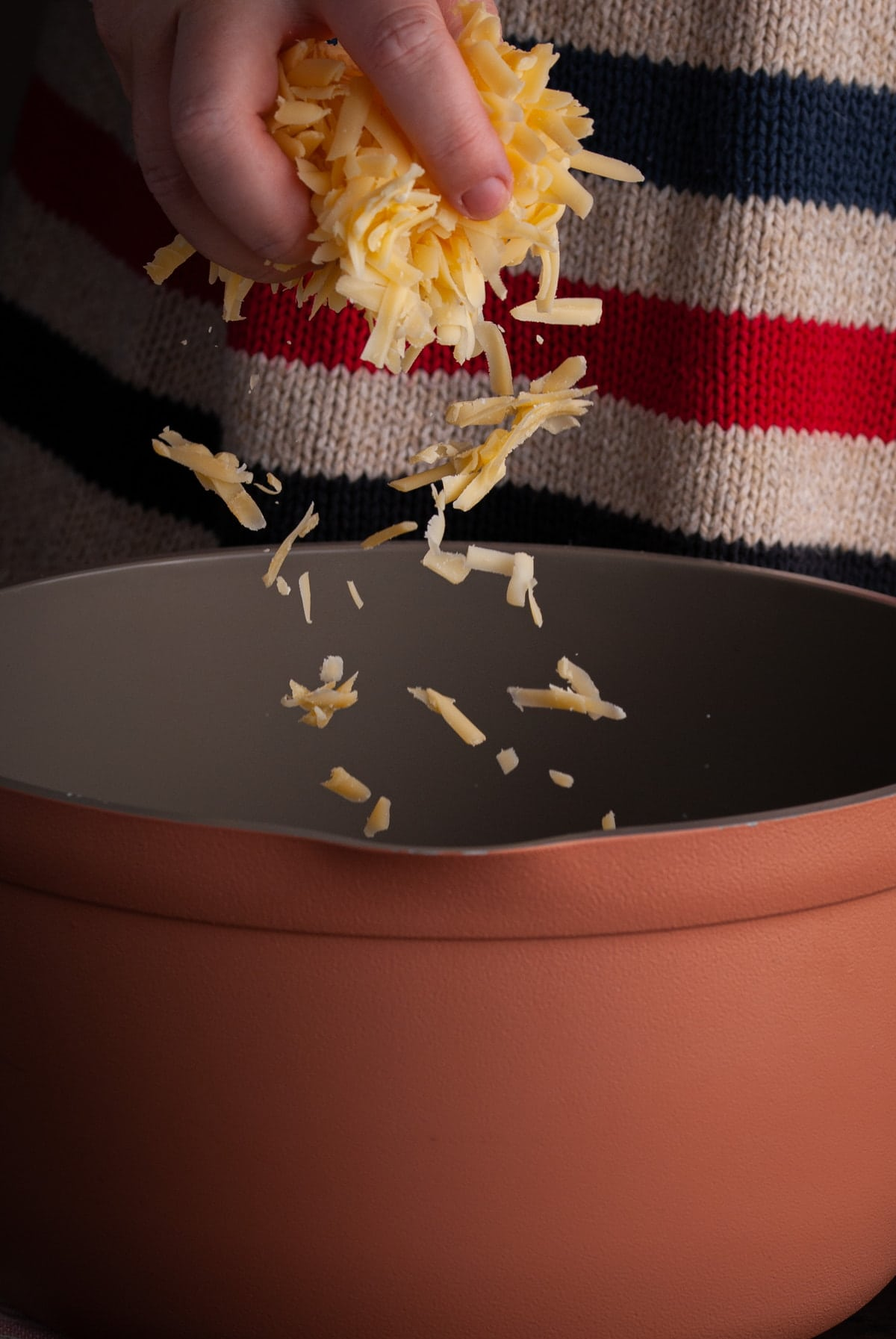 adding brie and gouda cheese to large pot