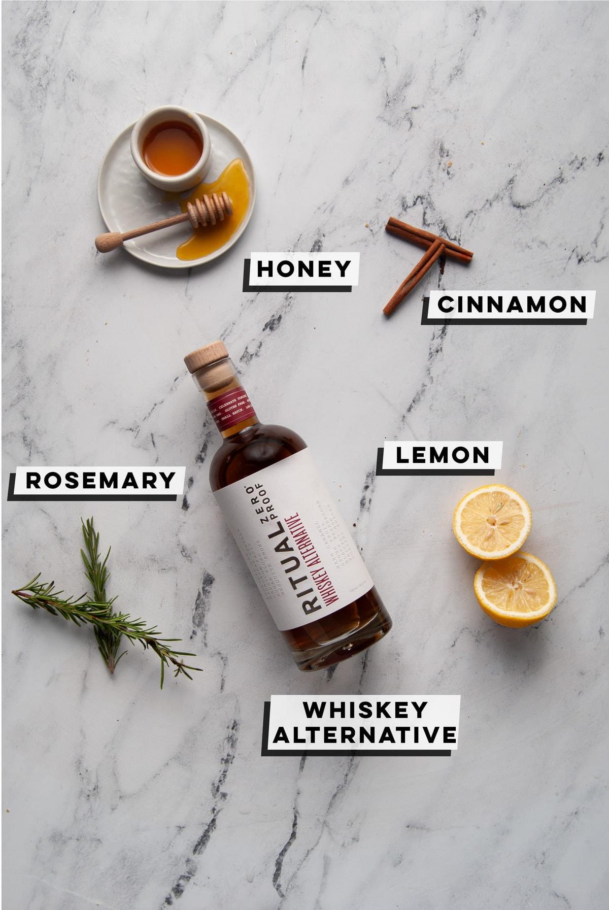 honey, cinnamon, rosemary, lemon, and Ritual Zero Proof Whiskey Alternative