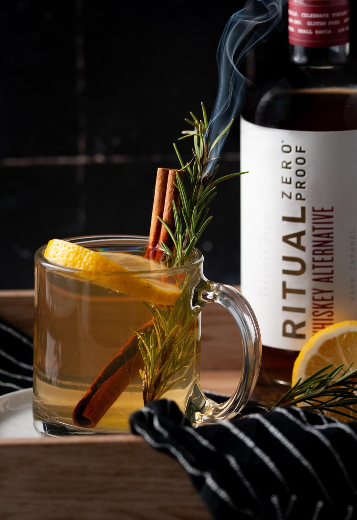 Non-Alcoholic Hot Toddy with Rosemary Garnish that is smoking